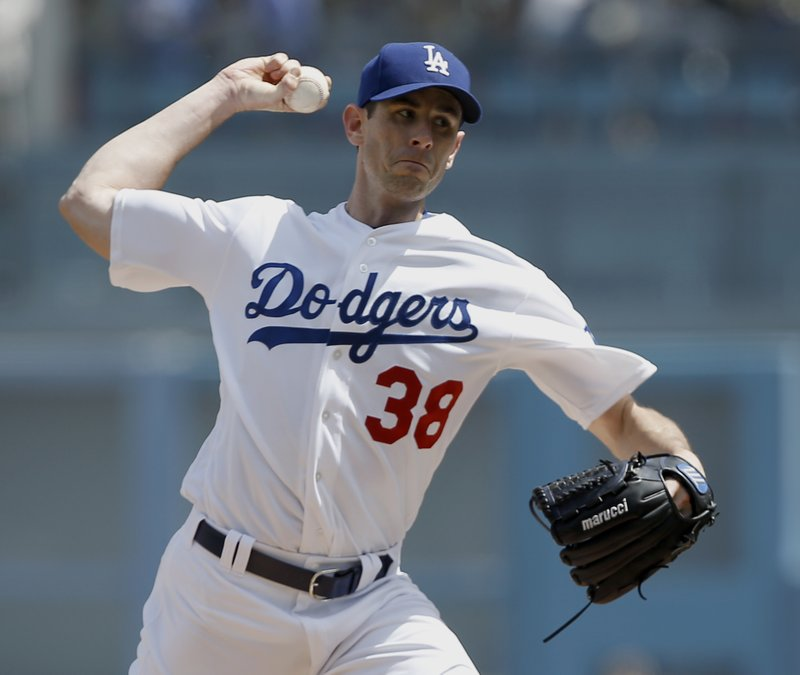 Los Angeles Dodgers' pitcher Brandon McCarthy throws to the plate against the San Diego Padres during the first inning of a baseball game in Los Angeles, Thursday, April 6, 2017. (AP Photo/Alex Gallardo)
