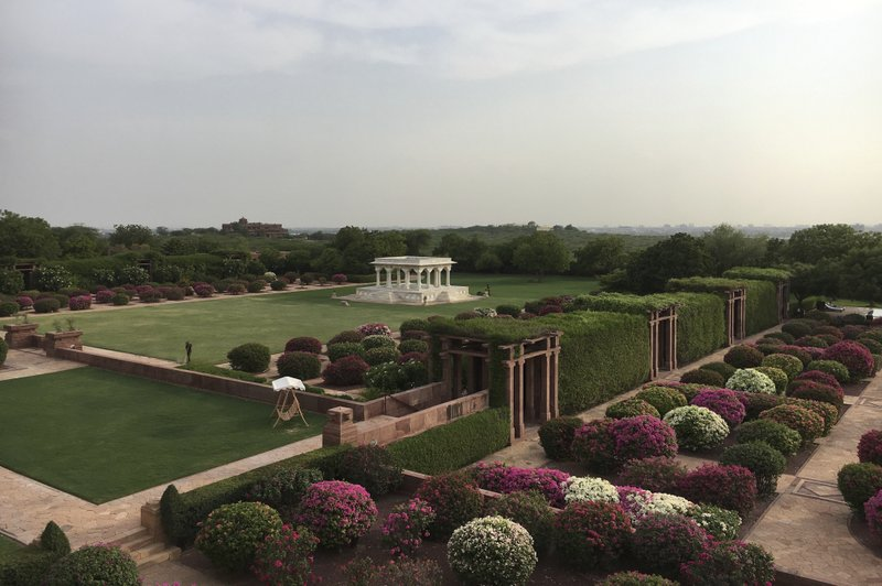 This Wednesday, June 26, 2017 photo shows a general view of the Umaid Bhawan Palace gardens in Jodhpur, India. In the summer of 1944, hundreds of royals gathered for the opening of Umaid Bhawan Palace, a magnificent sandstone edifice that dominates the skyline in India's northwestern city of Jodhpur. It was the last of its kind. Three years later, India was free from British colonial rule, and more than 500 princely states — the semi-sovereign principalities ruled by royal clans — faced an uncertain future. Most have faded into obscurity, but the family that built this palace continues to thrive — in part by converting a section of it into a hotel.