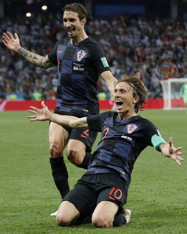 Croatia's Luka Modric, right, celebrates after scoring his side's second goal during the group D match between Argentina and Croatia at the 2018 soccer World Cup in Nizhny Novgorod Stadium in Nizhny Novgorod, Russia, Thursday, June 21, 2018.