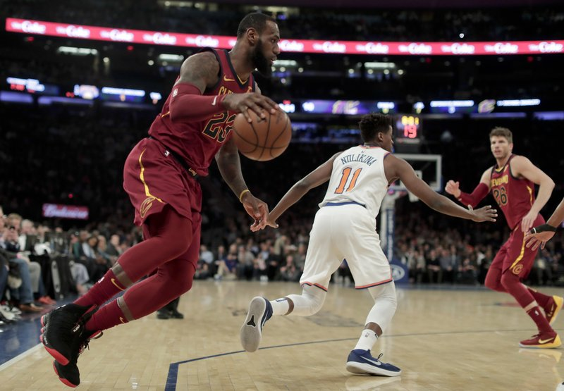innovative design b2907 bef09 James, Love lead Cavs past Knicks to 50th win, Central title