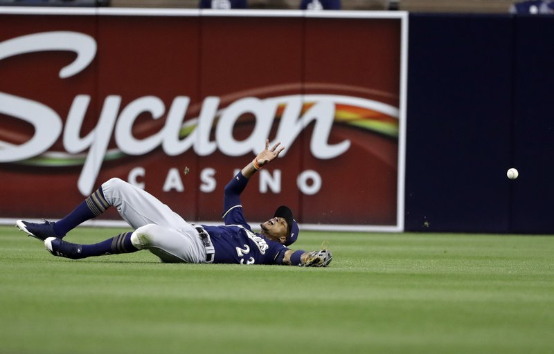 The ball bounces away from Milwaukee Brewers center fielder Keon Broxton on an RBI double by San Diego Padres' Yangervis Solarte during the sixth inning of a baseball game Wednesday, May 17, 2017, in San Diego. (AP Photo/Gregory Bull)