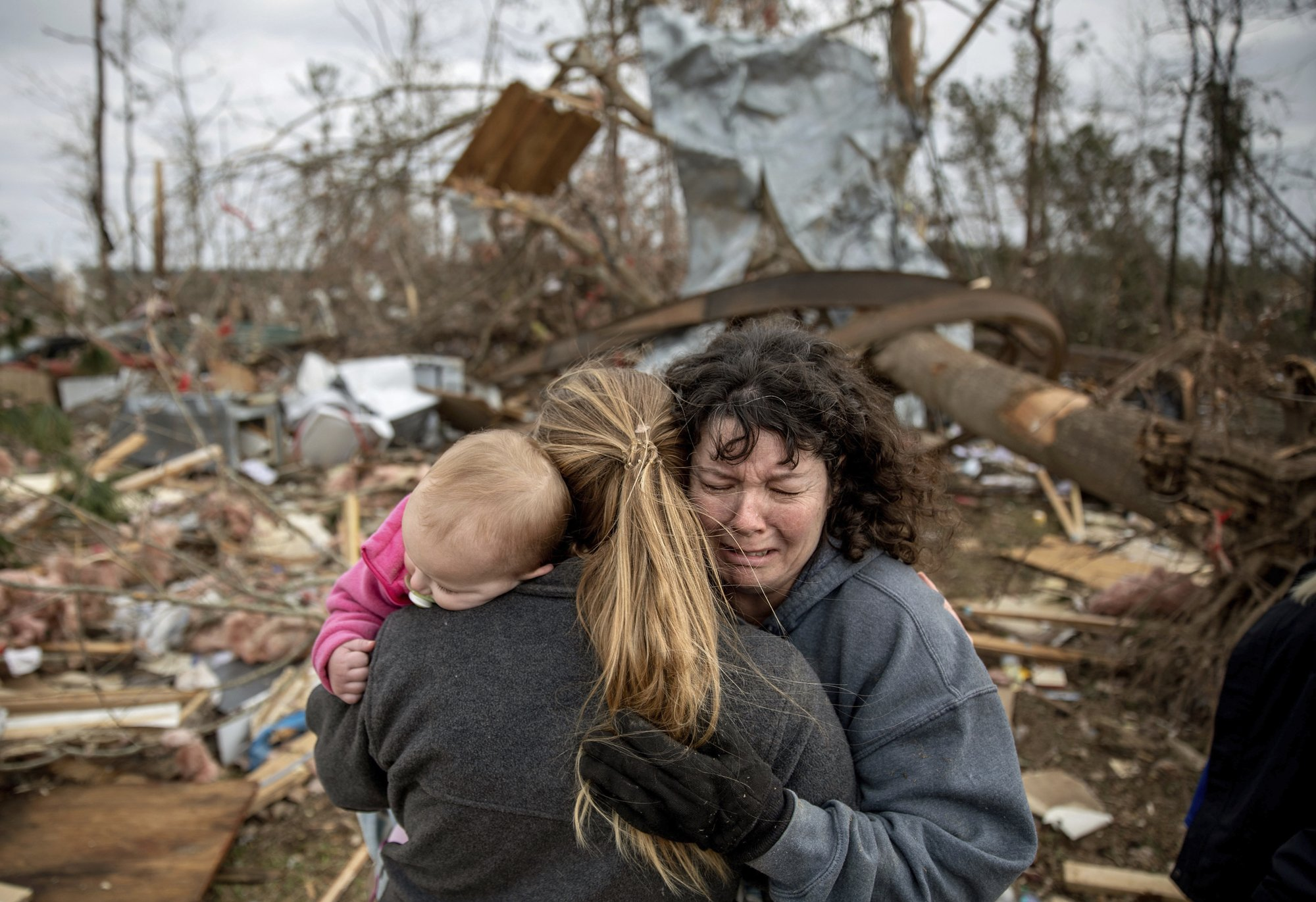 23 dead, dozens missing in tornado-blasted Alabama community