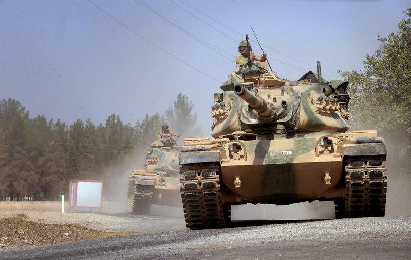Uneasy truce holds between Syrian Kurds, Turkey