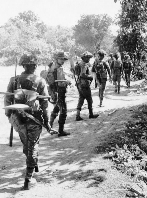 In this Dec. 7, 1971, file photo, Indian troops advance inside the Northwest sector of East Pakistan. In 1971 India Pakistan fought their third war in what was then East Pakistan. Indian troops supported secessionists fighting for Bangladesh's independence from Pakistan. The war ended with the creation of Bangladesh.