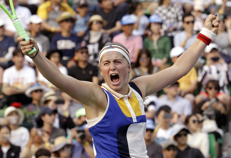 In this Sunday, Sept. 24, 2017, file photo, Jelena Ostapenko of Latvia celebrates after defeating Beatriz Haddad Maia of Brazil during their final match at the Korea Open tennis championship in Seoul, South Korea.