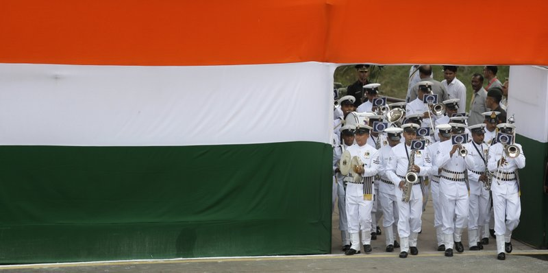 In this Tuesday, Aug. 15, 2017, file photo, Indian Naval band marches in at the historical Red Fort to celebrate Independence Day in New Delhi, India. India Tuesday commemorated its Independence in 1947 from British colonial rule.