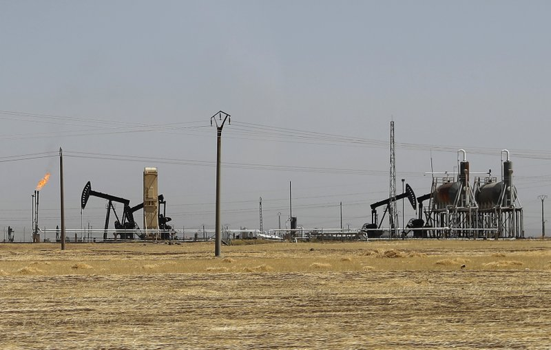 U.S.-backed fighters seize oil field from ISIS