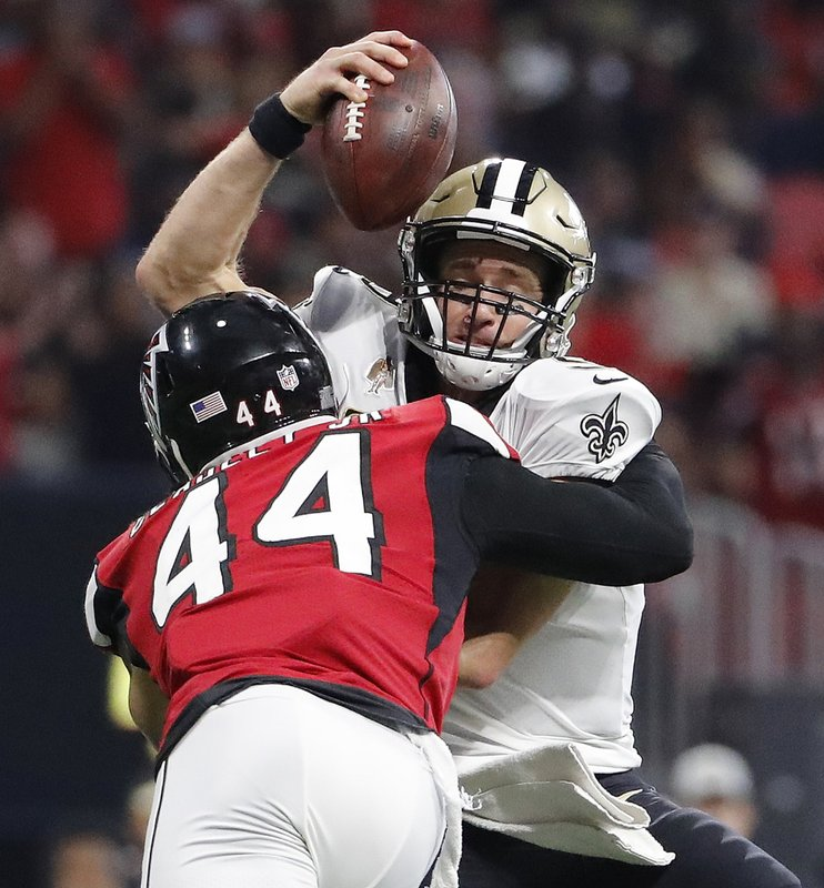 New Orleans Saints quarterback Drew Brees (9) is sacked by Atlanta Falcons  linebacker Vic Beasley (44) during the second half of an NFL football game 367595ed7