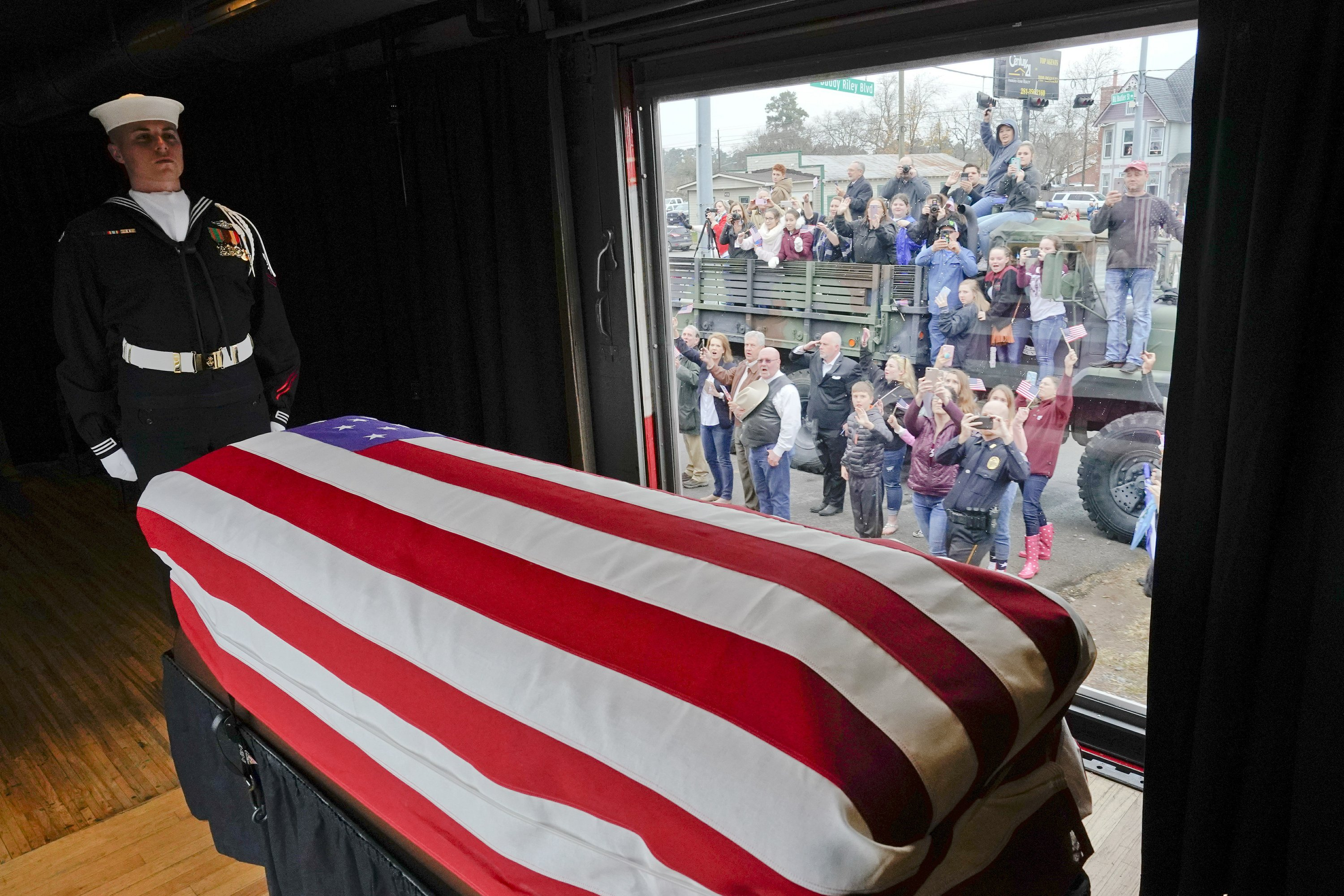The Latest: Bush funeral train-squashed coins a hot keepsake