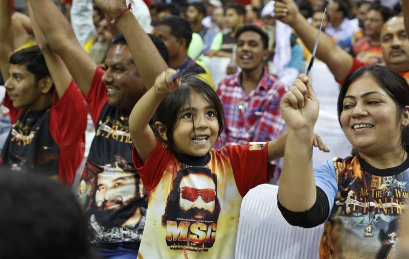 "In this Oct. 5, 2016, file photo, a child wears a T-shirt with a portrait of Indian spiritual guru, who calls himself Dr. Saint Gurmeet Singh Ram Rahim Insan, during a press conference ahead of the release of the guru's film ""MSG, The Warrior Lion Heart,"" in New Delhi, India. A judge on Monday, Aug. 28, 2017, sentenced the popular and flamboyant Indian spiritual guru to prison on charges of raping two female followers."