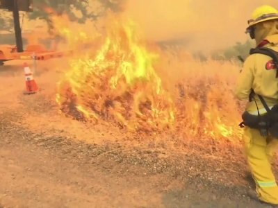 Firefighters Light Backfires to Slow Blazes