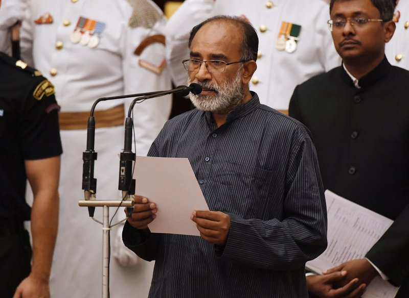 Retired bureaucrat Alphons Kannanthanam takes the oath during the swearing-in ceremony of new ministers at the Presidential Palace in New Delhi, India, Sunday, Sept.3, 2017. India Prime Minister Narendra Modi, on Sunday reshuffled some of his key minister's portfolios to refurbish his government's image, which has been dented by falling economic indicators.