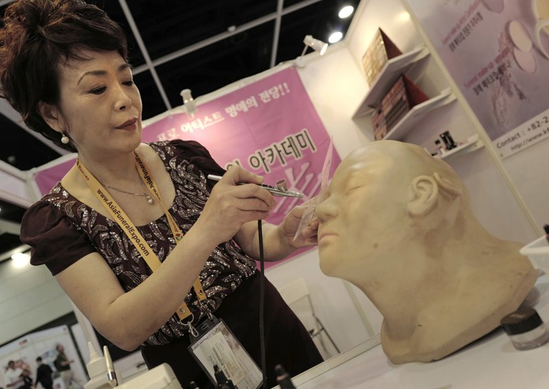 Lee Jong-lan, South Korea's top funerary beautician demonstrates her airbrushing technique for covering up discolored or damaged skin on corpses at the Asia Funeral and Cemetery Expo & Conference in Hong Kong, Thursday, May 18, 2017. The expo underscores how for some investors Asia's rapidly aging population makes its death industry a potentially lucrative market. Asia's aging population is projected to hit 923 million by mid-century, according to an Asian Development Bank, putting the region on track to become the oldest in the world.