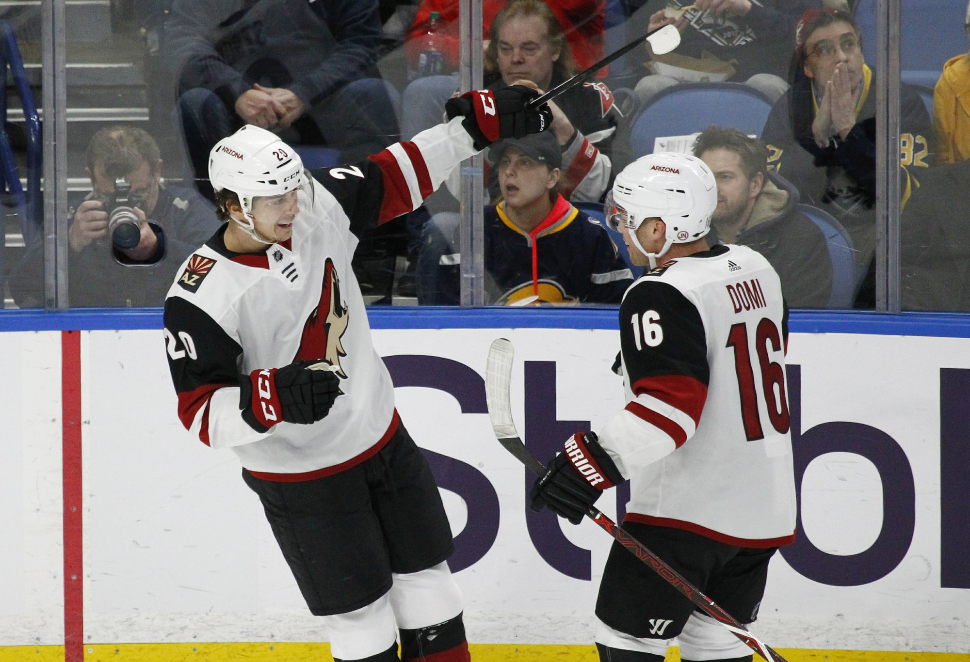 724d15631 Arizona Coyotes Dylan Strome (20) and Max Domi (16) celebrate a goal during  the first period of the team s NHL hockey game against the Buffalo Sabres  on ...