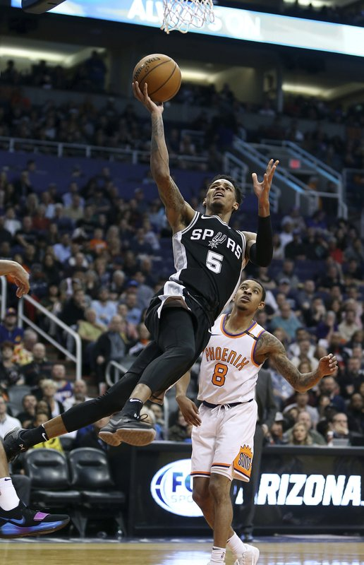 114230c4968 Depleted Spurs beat Suns for 8th win in 9 games