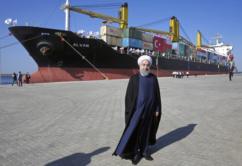 Iranian President Hassan Rouhani poses during the inauguration a newly built extension of the port of Chabahar, near the Pakistani border, on the Gulf of Oman, southeastern Iran, Sunday, Dec. 3, 2017. The $340 million project was constructed by a Revolutionary Guard-affiliated company, Khatam al-Anbia, the largest Iranian contractor of government construction projects. It brings the port's capacity to 8.5 million tons of cargo, from the previous 2.5 million tons and challenges the Gwadar port across the border in Pakistan. (AP Photo/Ebrahim Noroozi)