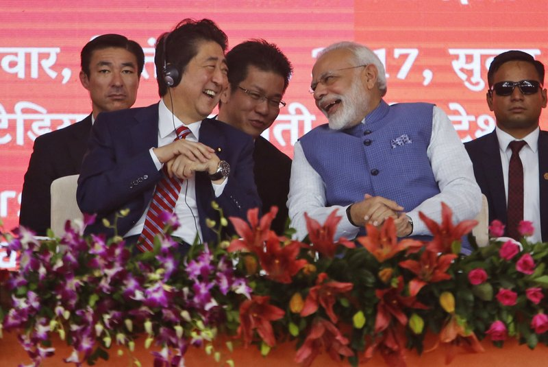 Japanese Prime Minister Shinzo Abe, left and Indian Prime Minister Narendra Modi share a lighter moment during the ground breaking ceremony for high speed rail project in Ahmadabad, India, Thursday, Sept. 14, 2017.