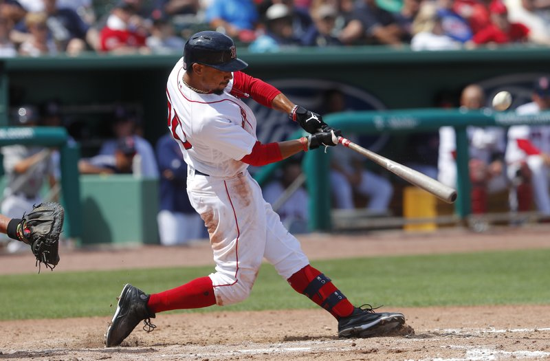 a7d5d509b Boston Red Sox  Mookie Betts connects on a solo-home run in the seventh  inning of a spring training baseball game against the Atlanta Braves  Saturday