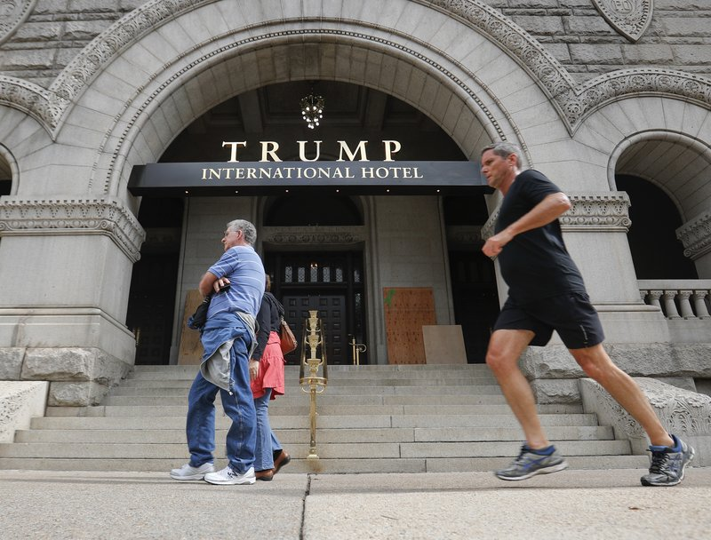 plywood covers up graffiti at the entrance to the trump international hotel sunday oct 2 2016 in washington district of columbia police said someone