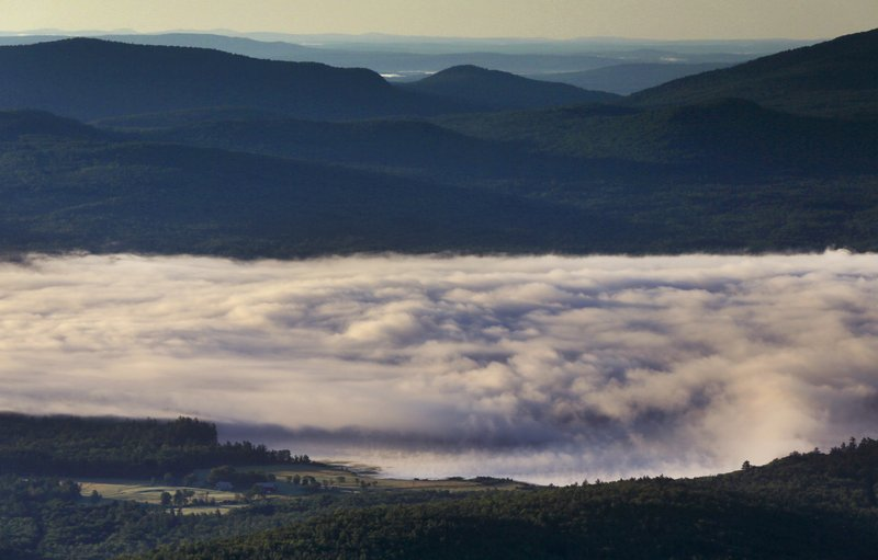 A billowy layer of fog hovers over Webb Lake on a chilly morning where the temperature dropped into the mid-40s, Wednesday, July 26, 2017, in Weld, Maine.