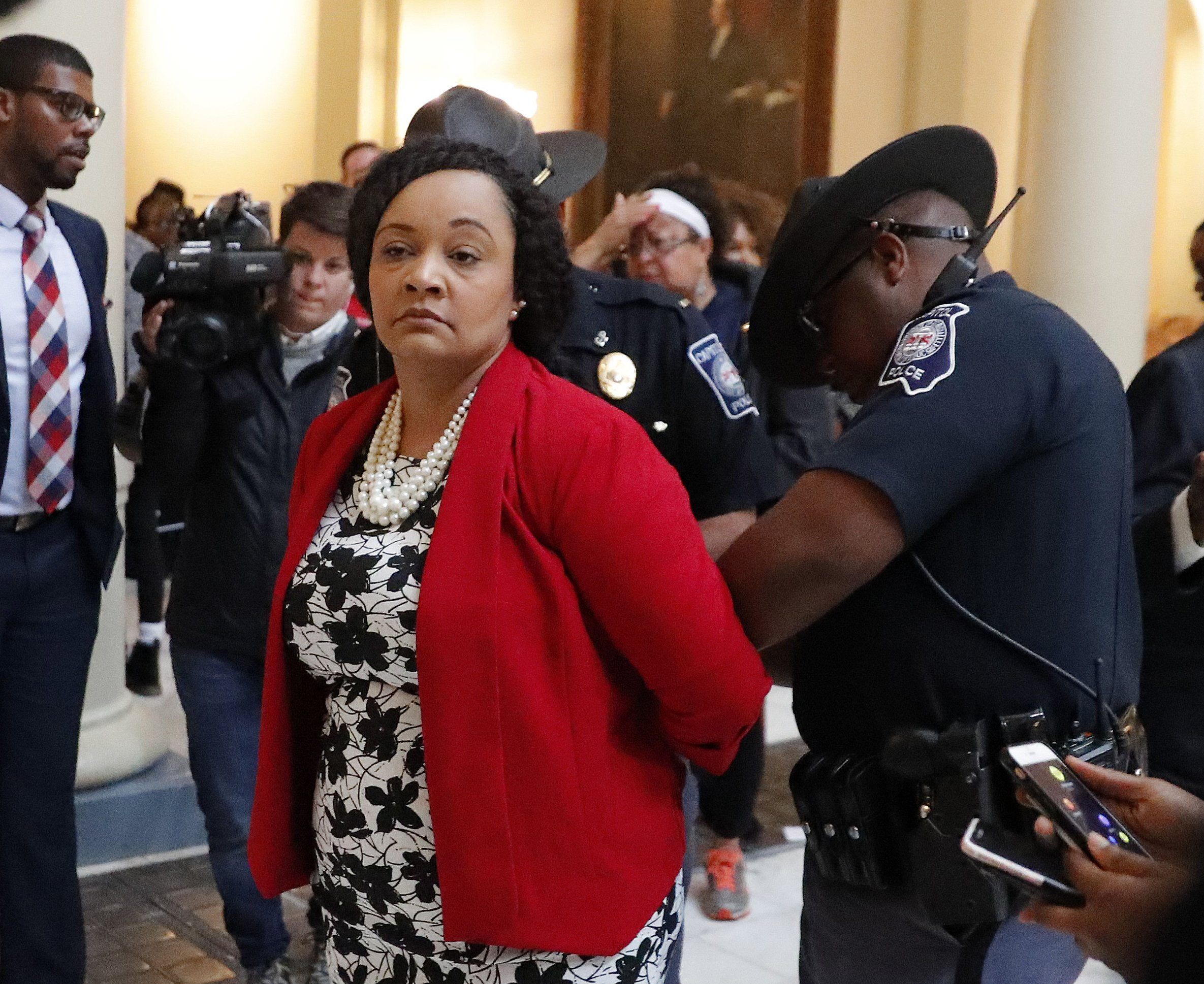 The Latest: 15 arrests at Georgia Capitol vote demonstration