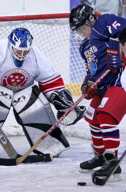 28, 2006 File Photo, 75 Year Old Slovak Forward Karol Fako, Right,  Challenges For The Puck With Goalie Sergei Mylnikov, Left, During Their  Friendly Match U201c ...