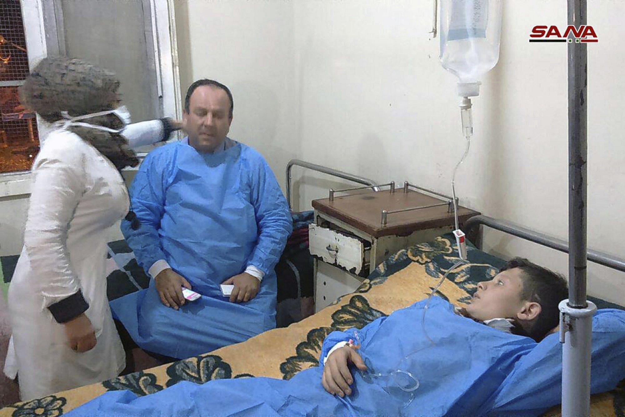 Syria state TV: 50 injured in rebel poison gas attack