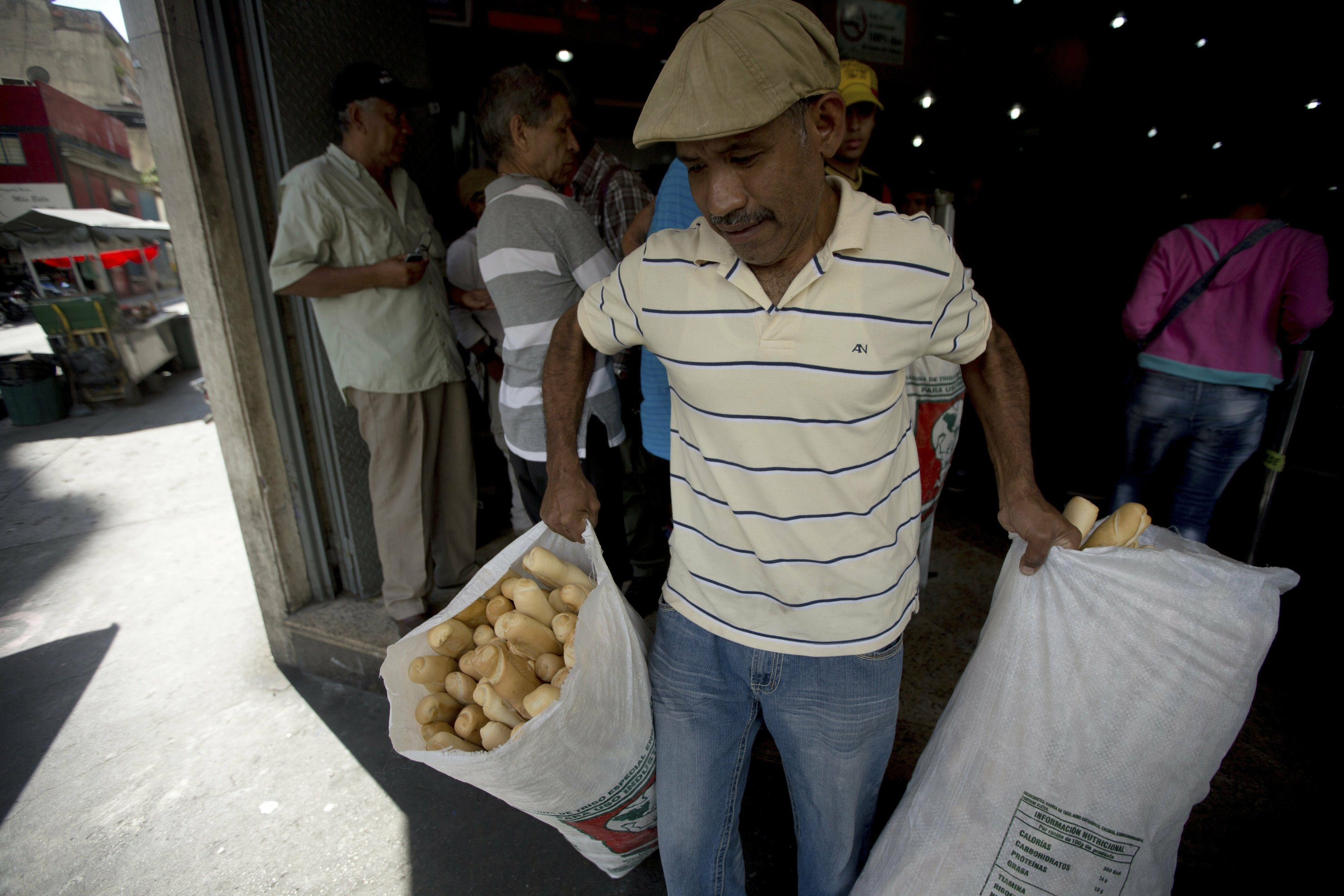 Venezuela's socialist leaders seize bakeries in 'bread war'