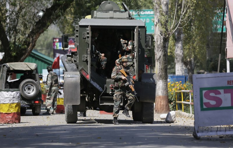 In this Sept. 18, 2016, file photo, Indian army soldiers arrive at the army base which was attacked by suspected rebels in the town of Uri, west of Srinagar, Indian controlled Kashmir. Suspected rebels sneaked into the Indian army base in Kashmir and killed 18 soldiers. Four attackers were also killed.