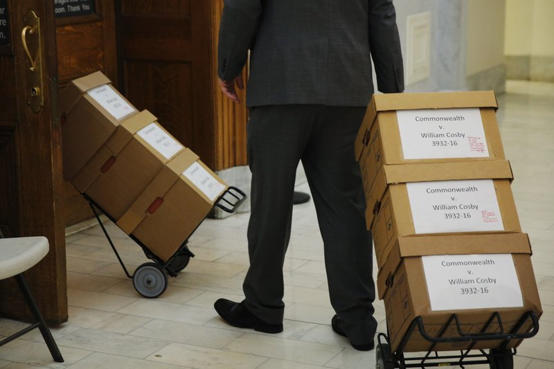 Boxes of documents are wheeled into the courtroom before actor and comedian Bill Cosby arrives for the sixth day of his sexual assault retrial at the Montgomery County Courthouse in Norristown, Pennsylvania