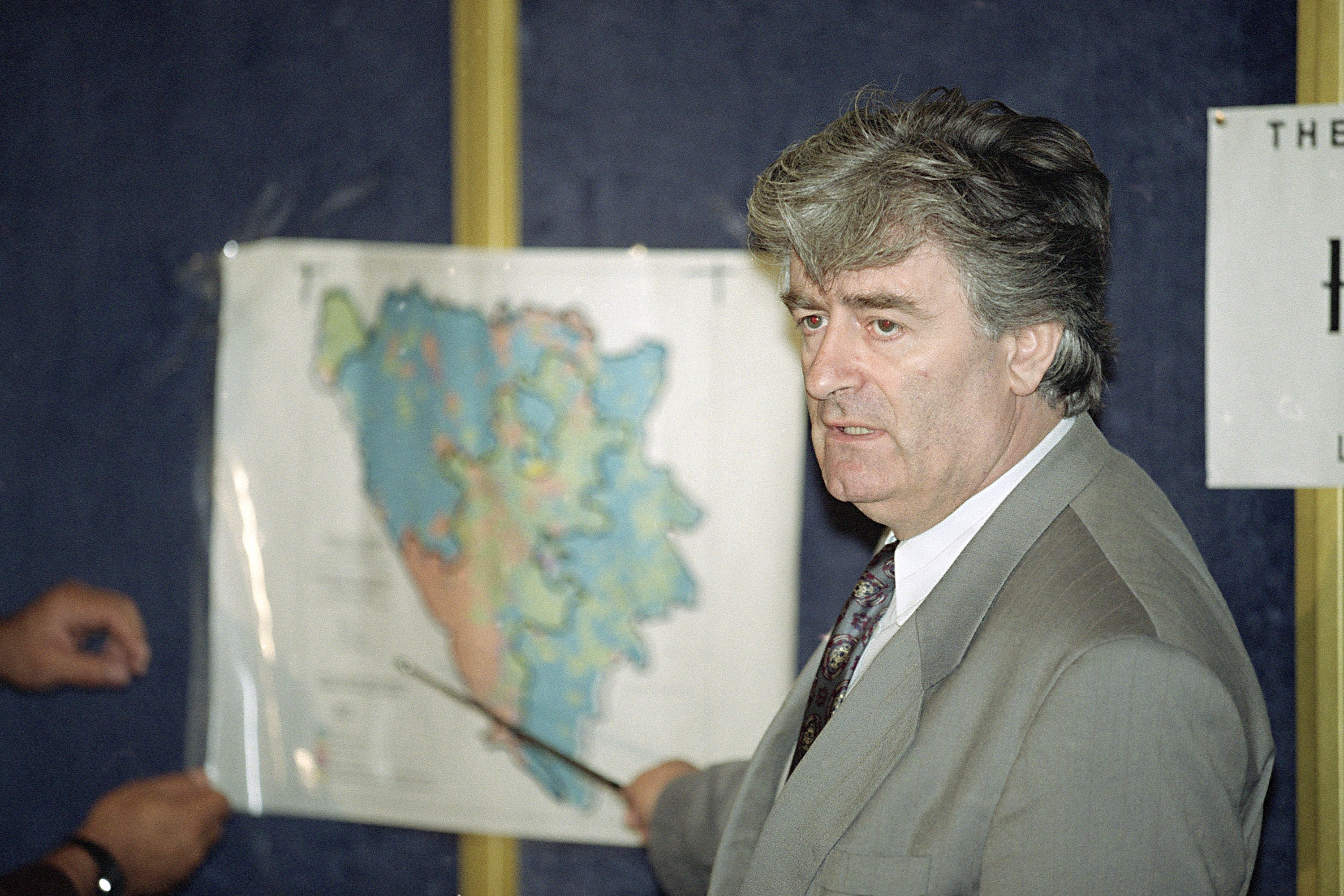 The Latest: UN judges up Karadzic sentence to life in prison