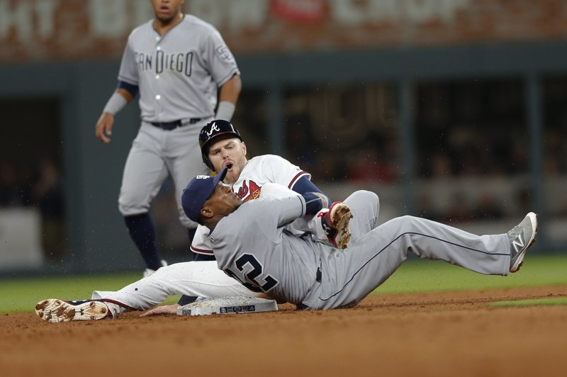 Atlanta Braves' Freddie Freeman (5) is tagged out by San Diego Padres shortstop Erick Aybar (8) as he tries to steal second base in the fifth inning of a baseball game, Saturday, April 15, 2017, in Atlanta. (AP Photo/John Bazemore)