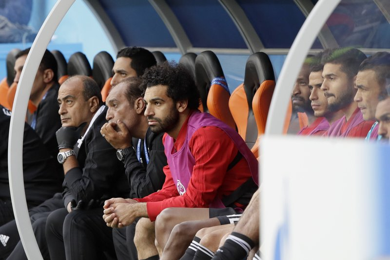Egypt's Mohamed Salah, center, watches his team during the group A match between Egypt and Uruguay at the 2018 soccer World Cup in the Yekaterinburg Arena in Yekaterinburg, Russia, Friday, June 15, 2018.