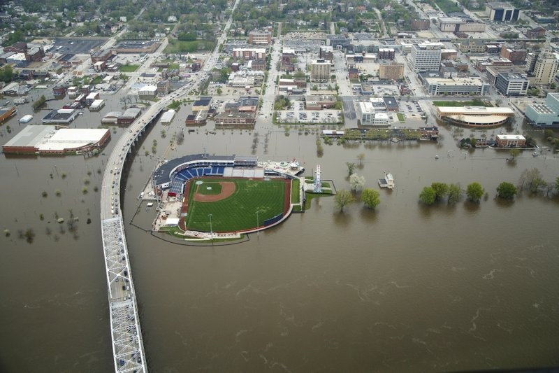 The Latest: Flood reaches record level at Quad Cities