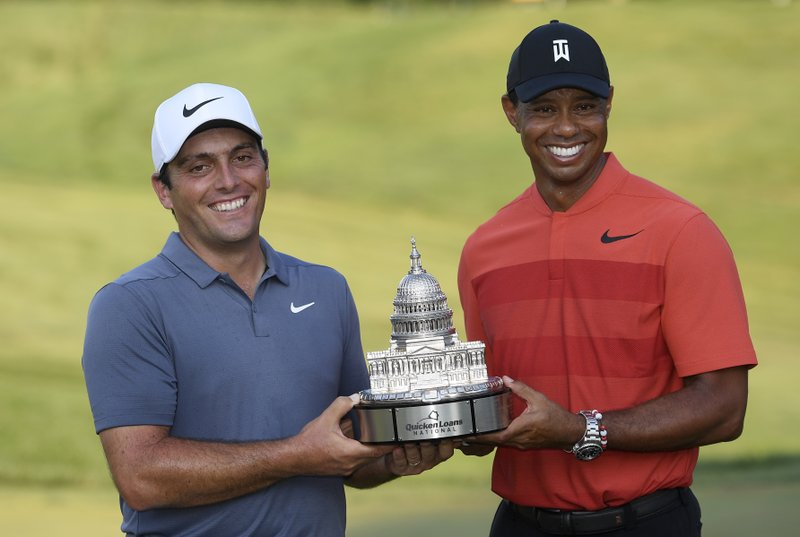 Defending Quicken Loans National champ Francesco Molinari with Tiger Woods