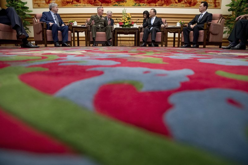 In this Aug. 17, 2017, file photo, U.S. Chairman of the Joint Chiefs of Staff, Marine Corps Gen. Joseph Dunford, second from left, accompanied by U.S. Ambassador to China Terry Branstad, left, meets with China's State Counselor Yang Jiechi, second from right, at the Zhongnanhai Leadership Compound in Beijing.