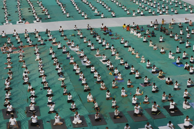Thousands of Indians perform yoga as they mark International Day of Yoga in Allahabad, India, Thursday, June 21, 2018. Yoga enthusiasts across the world Thursday took part in mass yoga events to mark International Yoga Day.