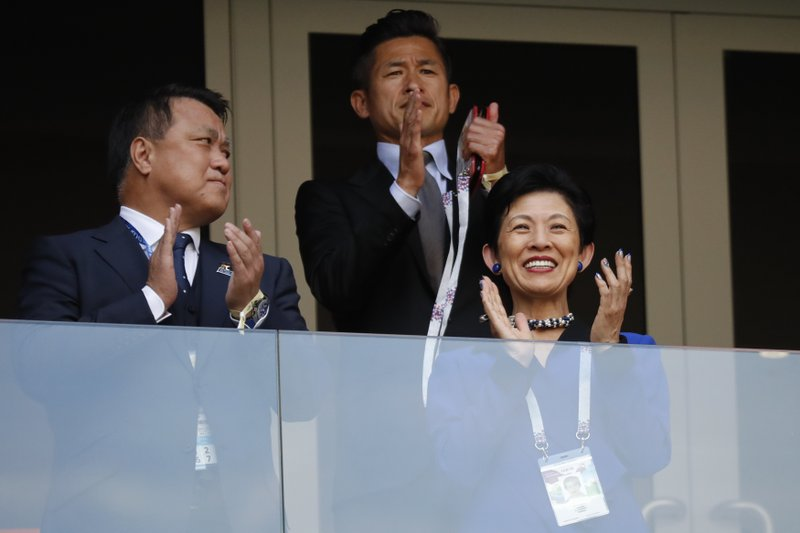 Japan's Princess Takamado, right, applauds prior to the group H match between Colombia and Japan at the 2018 soccer World Cup in the Mordavia Arena in Saransk, Russia, Tuesday, June 19, 2018.