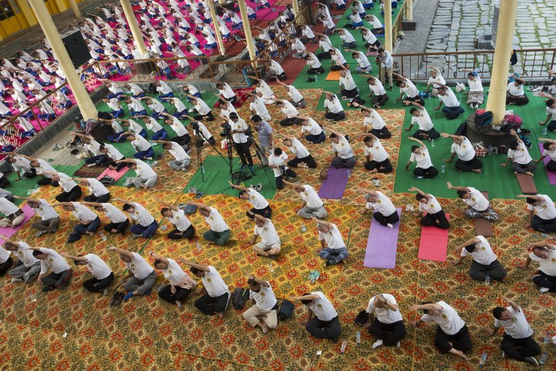 Exile Tibetans participate in a joint yoga session at the Tsuglakhang temple to mark the International Yoga Day in Dharmsala, India, Thursday, June 21, 2018. Yoga enthusiasts across the world Thursday took part in mass yoga events to mark International Yoga Day.
