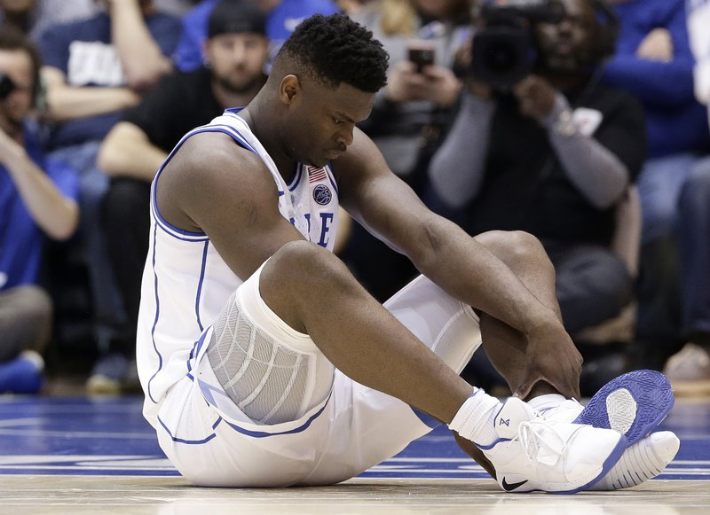6195e72797d Zion s freak injury ripples in basketball