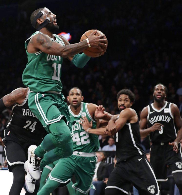 plus de photos c3628 07399 Masked man: Irving returns as Celtics win 13th straight