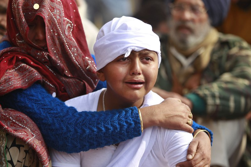 Son of Indian civilian Gopal Dass who was killed in Pakistani firing and shelling, wails at Jhiri village in Kanachack district of Jammu and Kashmir, India, Monday, Jan.22,2018. Officials say Indian and Pakistani soldiers have again targeted each other's posts and villages along their volatile frontier in disputed Kashmir after a day's lull, killing at least one civilian.