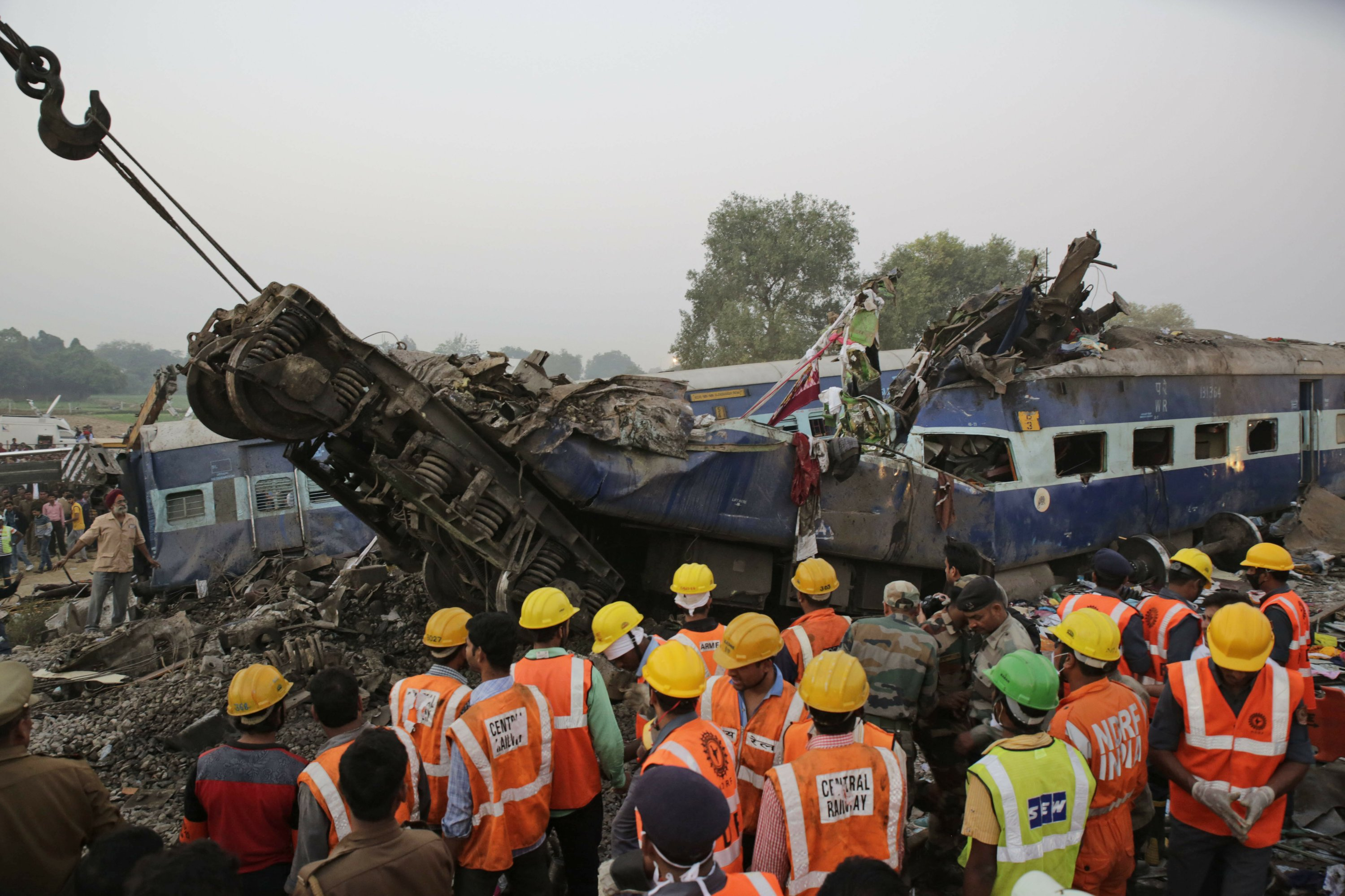 Rescuers finish search of Indian train wreck, 127 dead