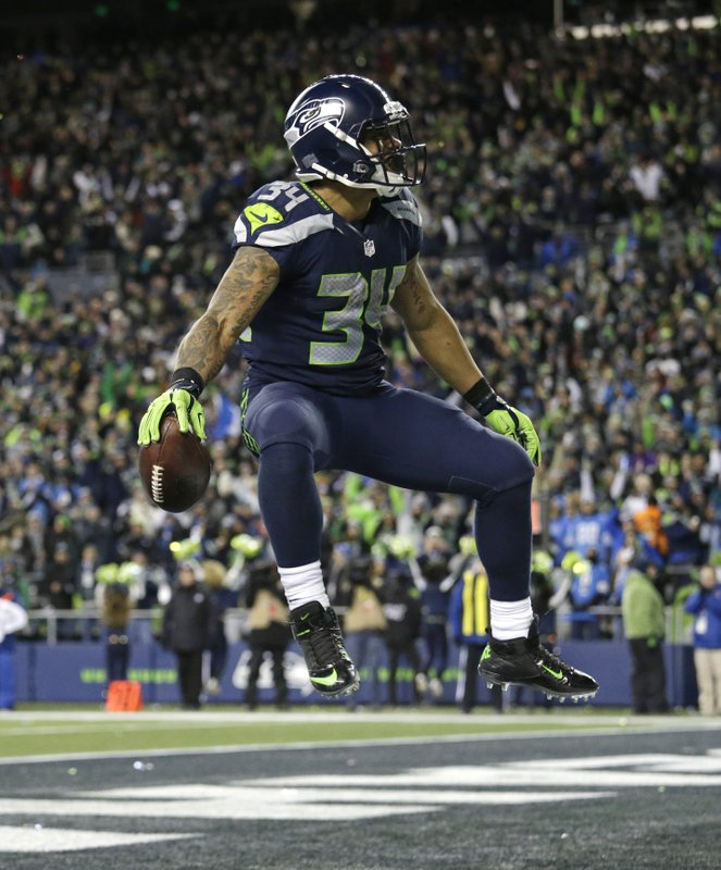 0f80b0e8e3e Seattle Seahawks running back Thomas Rawls celebrates after he rushed for a  touchdown against the Detroit Lions in the second half of an NFL football  NFC ...
