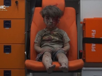 Raw: Haunting Image of Boy Rescued in Aleppo