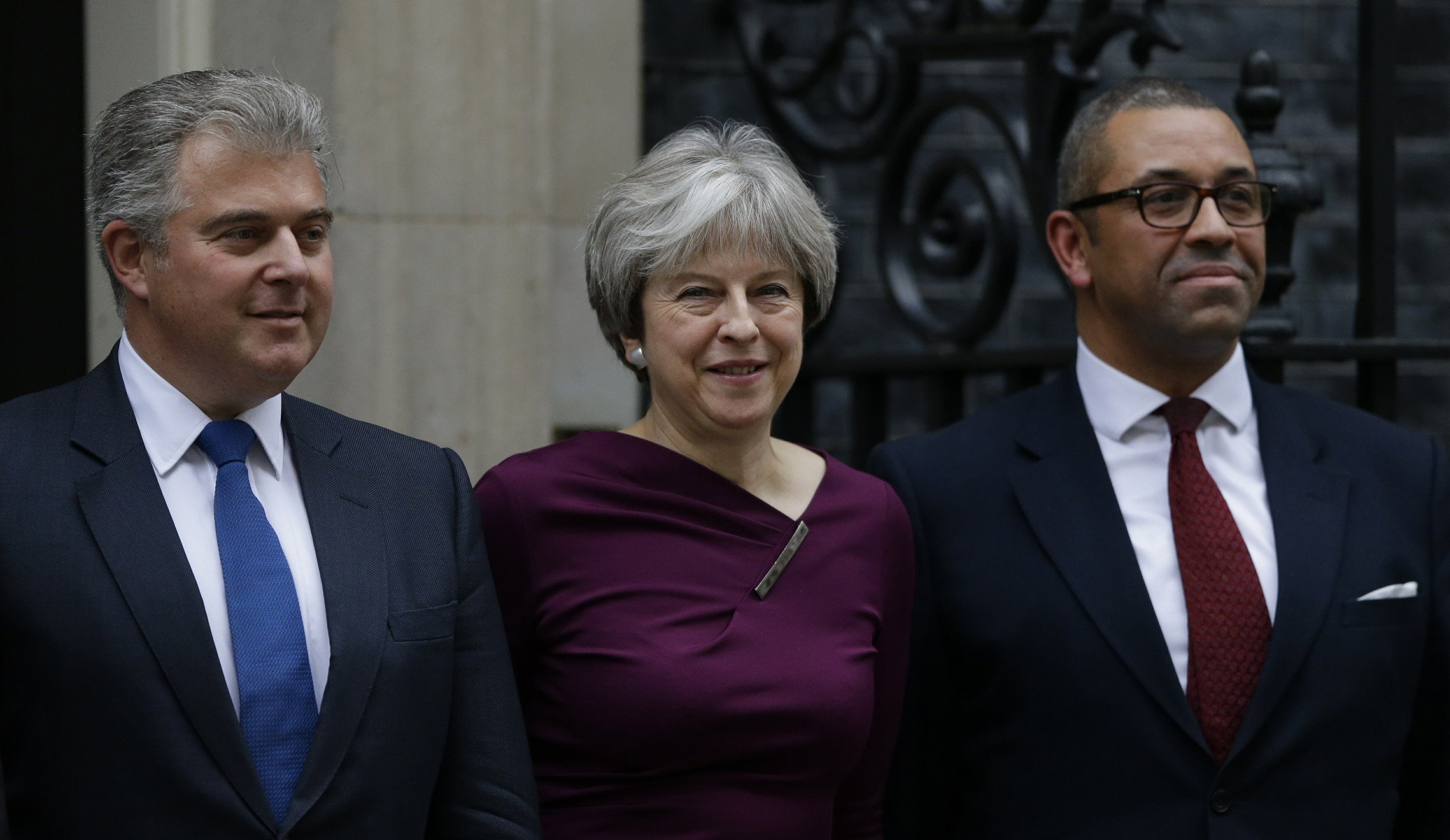 UK's May shuffles Cabinet, but Brexit divisions limit scope