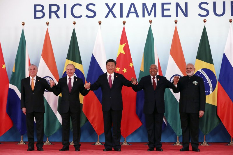 In this Monday, Sept. 4, 2017, file photo, from left, Brazil's President Michel Temer, Russian President Vladimir Putin, Chinese President Xi Jinping, South Africa's President Jacob Zuma and Indian Prime Minister Narendra Modi pose for a group photo during the BRICS Summit at the Xiamen International Conference and Exhibition Center in Xiamen, southeastern China's Fujian Province.