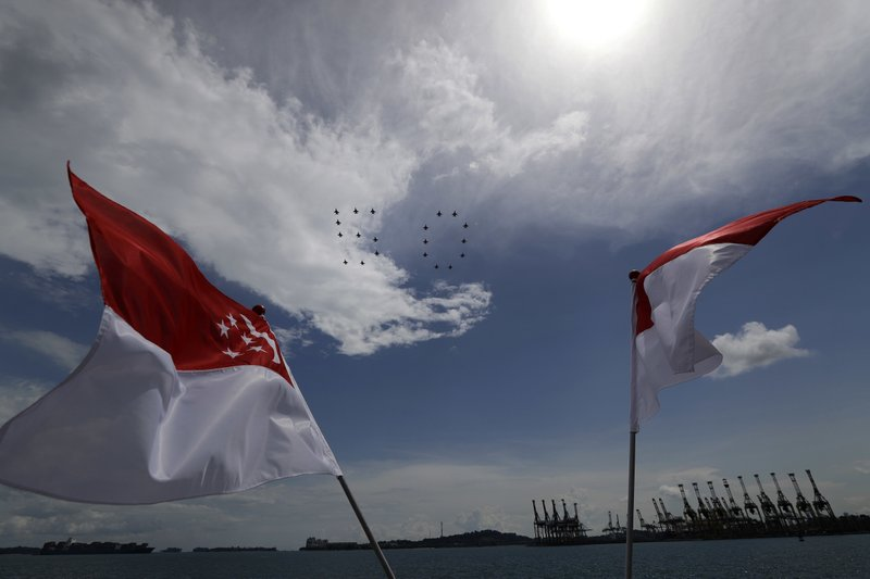 In this Thursday, Sept. 7, 2017, file photo, Ten F-16 jet fighters, from both the Republic of Singapore Air Force (RSAF) and Indonesian Air Force (TNI-AU) fly in the formation of the number 50 as the national flags of Singapore, left, and Indonesia fly in the foreground, in Singapore as part of the 50 year anniversary of diplomatic relations between the two countries.