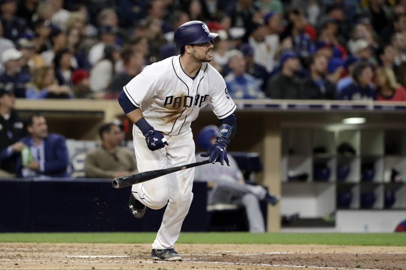 San Diego Padres' Austin Hedges watches his home run hit during the fourth inning of a baseball game against the Texas Rangers, Monday, May 8, 2017, in San Diego. (AP Photo/Gregory Bull)