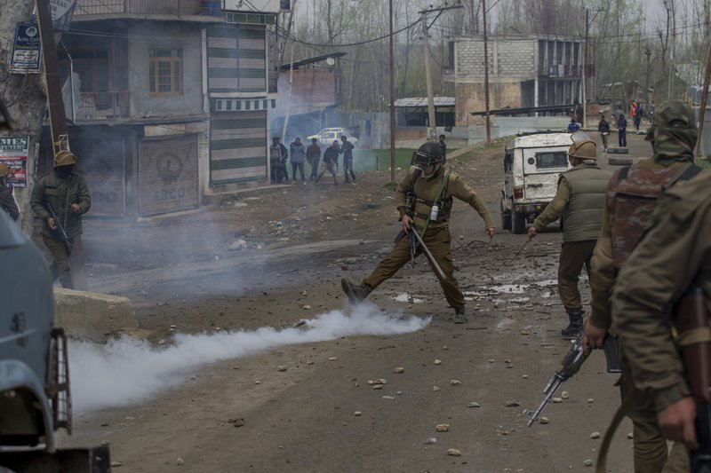 An Indian policeman kicks an exploded tear gas shell during a protest near the site of a gun battle in Chadoora town, about 25 kilometers (15 miles) south of Srinagar, Indian controlled Kashmir, Tuesday, March 28, 2017. Three civilians were killed and 28 other people were injured in anti-India protests that erupted Tuesday following a gunbattle between rebels and government forces that killed a rebel in disputed Kashmir, police and witnesses said. The gunbattle began after police and soldiers cordoned off the southern town of Chadoora following a tip that at least one militant was hiding in a house, said Inspector-General Syed Javaid Mujtaba Gillani. As the fighting raged, hundreds of residents chanting anti-India slogans marched near the area in an attempt to help the trapped rebel escape.